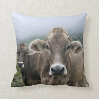 Alpine cows throw pillow