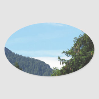 Alpine landscape with green fir and forest oval sticker
