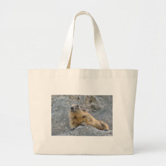 Alpine marmot on the roch large tote bag