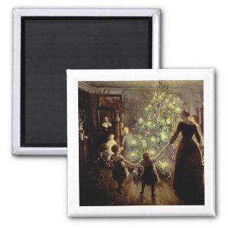 Alrededor del árbol de navidad iman de nevera