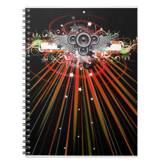 Altavoces de la música en vuelo con los rayos lase libros de apuntes con espiral