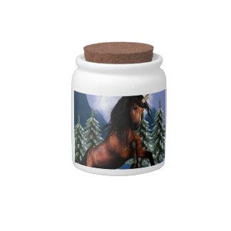 Alzar el tarro del caramelo del unicornio de la ca jarra para caramelo