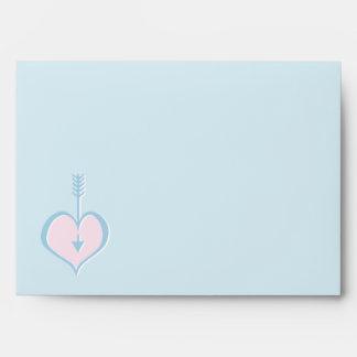 Amándole sobre rosado azul de la tarjeta