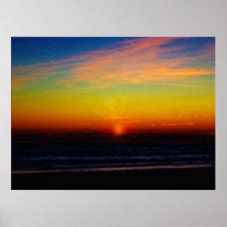 Amanecer en la playa póster