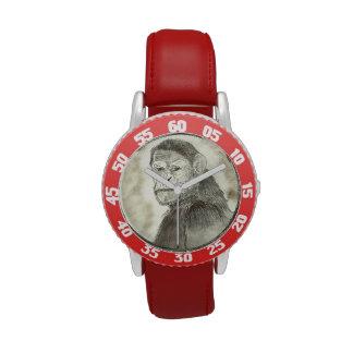 Amanecer rojo del reloj de los monos del planeta