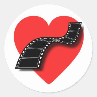 Amante de la película con el corazón y la tira etiqueta redonda