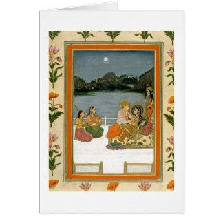 Amantes en una terraza por un lago iluminado por l tarjetas