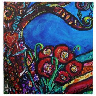 Amapolas rojas debajo del árbol de las servilletas