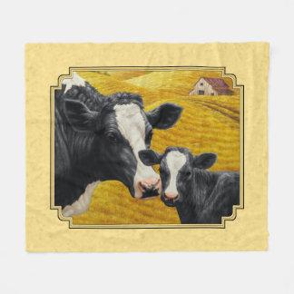 Amarillo de la granja de la vaca y del becerro de manta polar