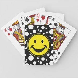 Amarillo sonriente divertido y puntos + su backg. naipes