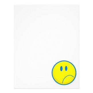 amarillo sonriente y azul de la cara triste tonta membrete