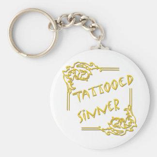 Amarillo tatuado del pecador llaveros