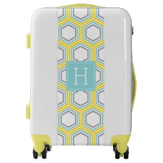 Amarillo y hexágonos modelo y monograma de la maletas