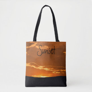 Amazing orange mountain sunset tote bag