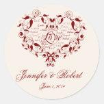 Ame en cualquier lengua en sello rojo del sobre etiquetas redondas