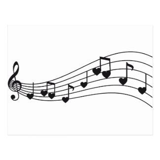 ame la música, las notas musicales rojas con los c postal