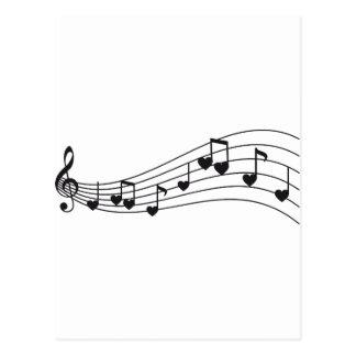 ame la música, las notas musicales rojas con los c tarjeta postal