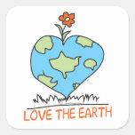 Ame la tierra etiqueta