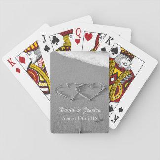 Ame los corazones en la cubierta de la arena de lo cartas de póquer