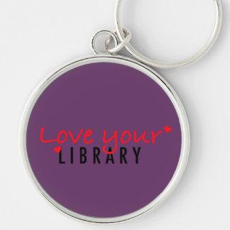 Ame su biblioteca llavero redondo plateado