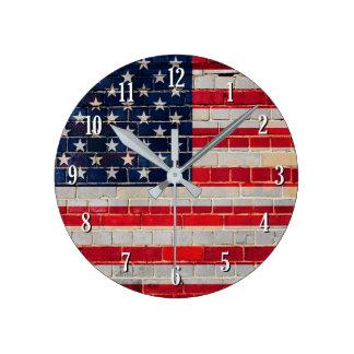 America flag on a brick wall round clock