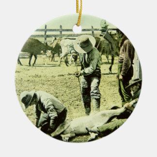 American cowboys branding a calf, c.1900 (photo) ceramic ornament
