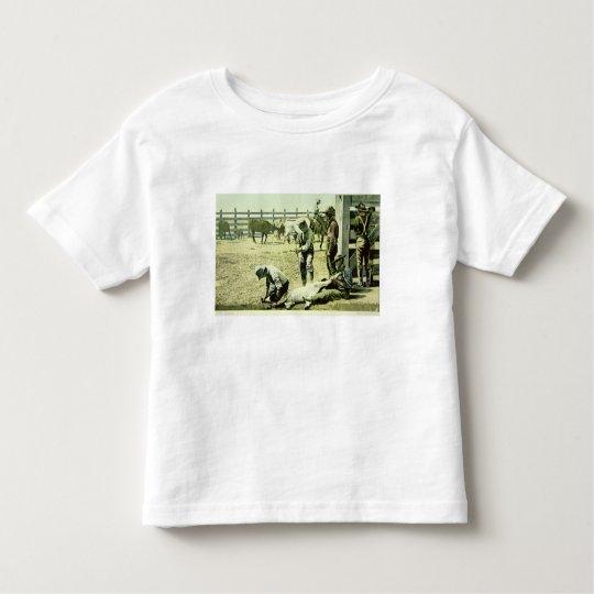 American cowboys branding a calf, c.1900 (photo) toddler t-shirt
