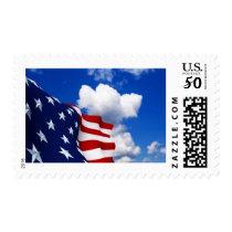 American Flag in blue skies Postage