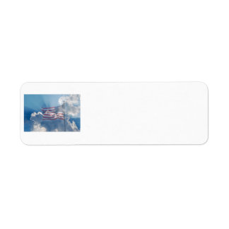 American flag over heavenly clouds label