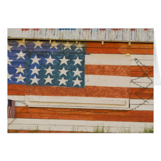 American flag painted onto fireworks stand near card