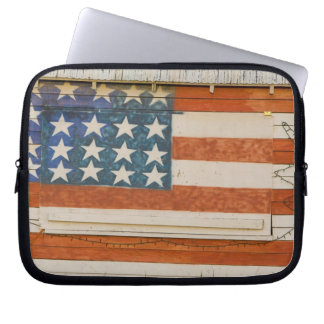 American flag painted onto fireworks stand near laptop computer sleeve