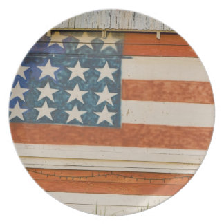 American flag painted onto fireworks stand near plate