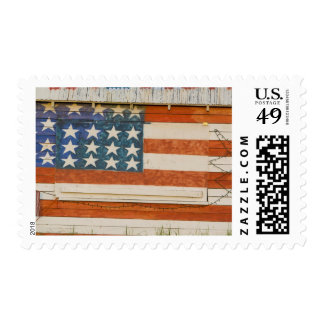 American flag painted onto fireworks stand near postage stamp