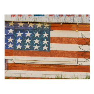 American flag painted onto fireworks stand near post cards