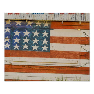 American flag painted onto fireworks stand near poster