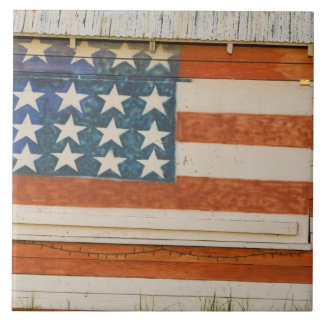 American flag painted onto fireworks stand near tile
