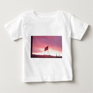 American flag storm waging behind baby T-Shirt