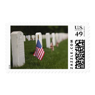 American flags on tombs of American Veterans on Postage