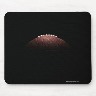 American football ball on black background mouse pad