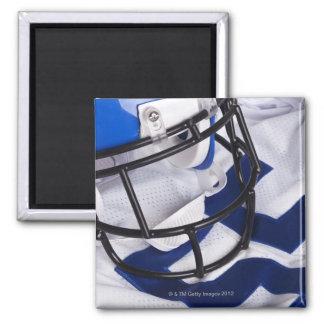 American football helmet and shirt still life fridge magnet