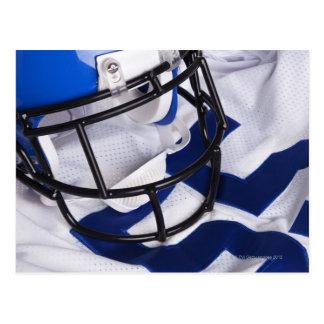 American football helmet and shirt still life postcard