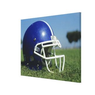 American football helmet in grass,close-up canvas print