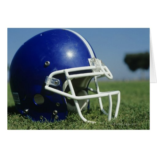 American football helmet in grass,close-up greeting cards