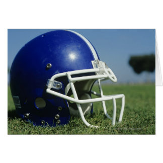American football helmet in grass,close-up greeting card