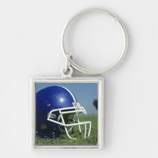 American football helmet in grass,close-up Silver-Colored square keychain
