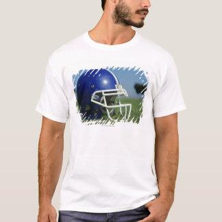 American football helmet in grass,close-up T-Shirt