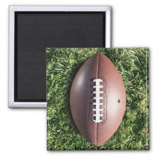 American football on grass fridge magnet