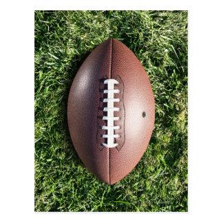 American football on grass postcard