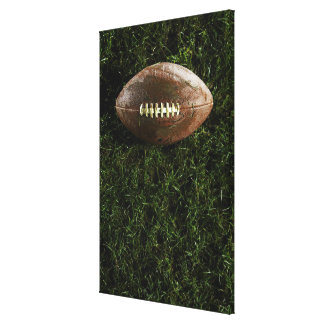 American football on grass, view from above canvas print