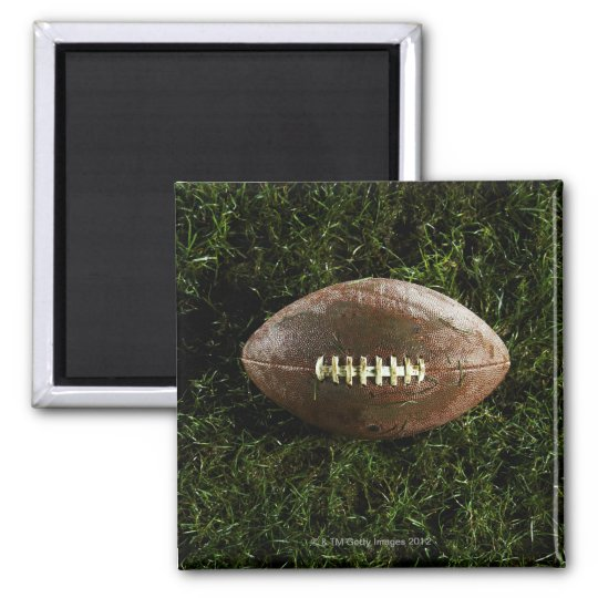 American football on grass, view from above magnet